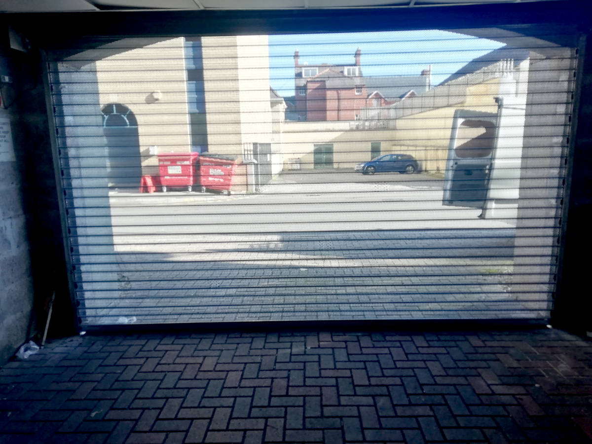 Image of Perforated Security Door on Communal Garage in Newport