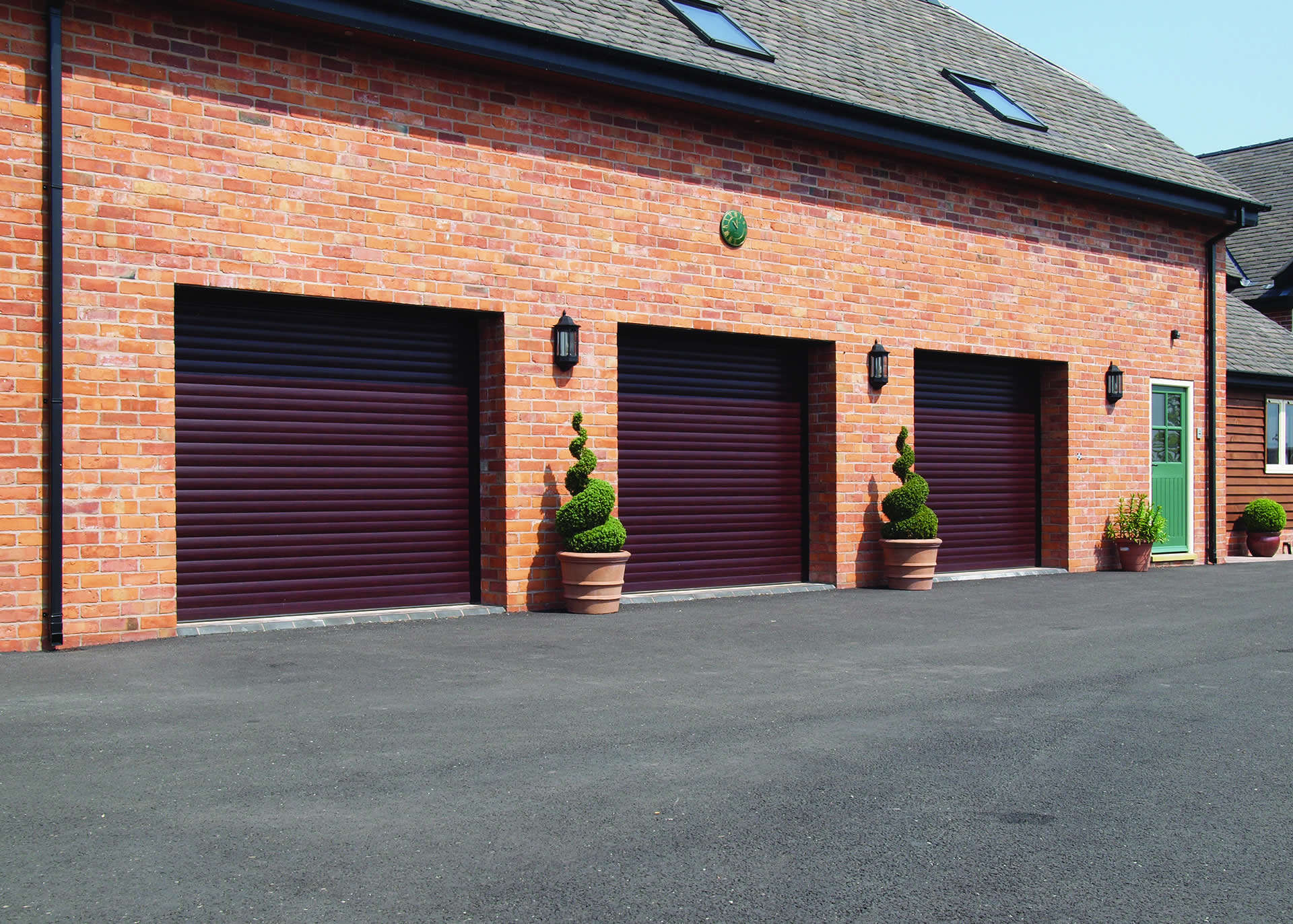An image of Garage Door Installation Triple Roller Shutters goes here.